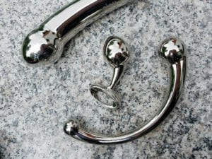 [Image: njoy Eleven, Pure Plug, and Pure Wand on granite. All three stainless steel sex toys are amazing.]