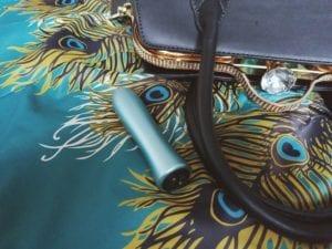 [Image: FemmeFunn Bougie Bullet aluminum bullet next to my purse]