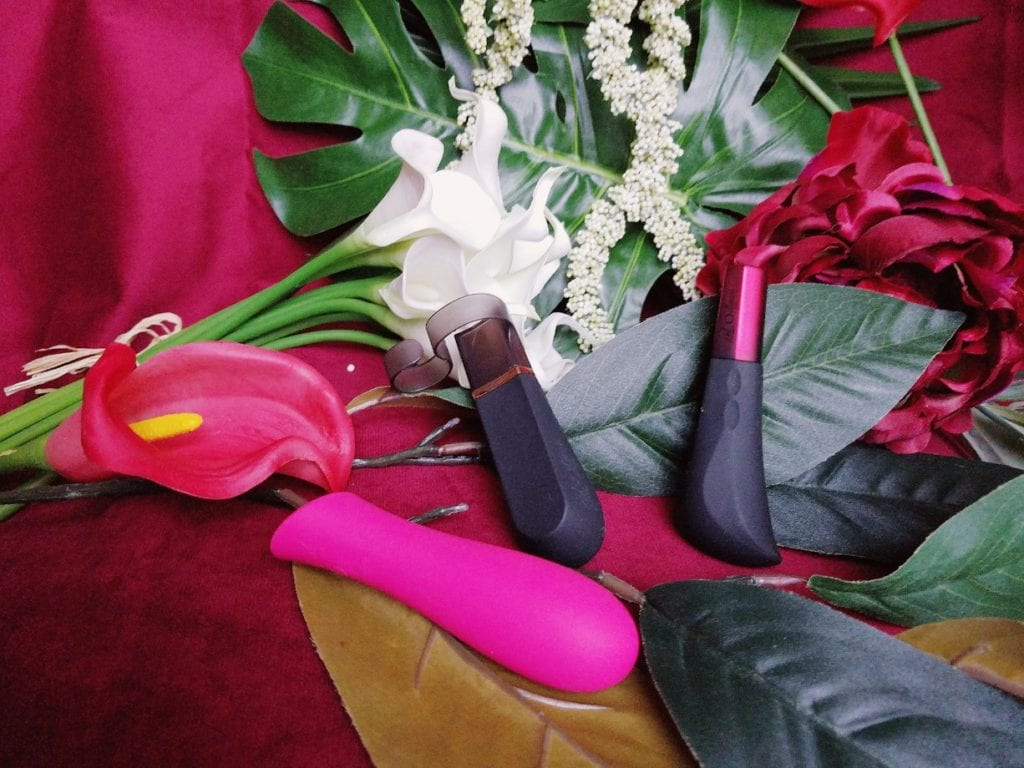 [Image: Hot Octopuss Digit Amo next to Digit and BMS Mini Swan Rose — all strong and rumbly vibrators I've reviewed]