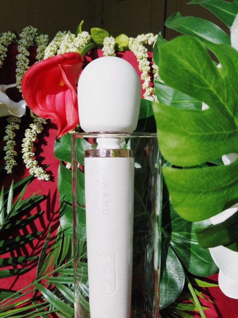 [Image: pearl white Le Wand Rechargeable body massager with rose gold accents]