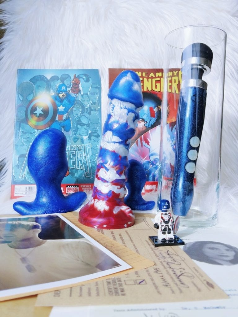 [Image: blue shimmer Oxballs Ergo plug next to photo of Steve Rogers, Uberrime A-Spot Avengers Patriot red white and blue marbled dildo, and Doxy Die Cast]