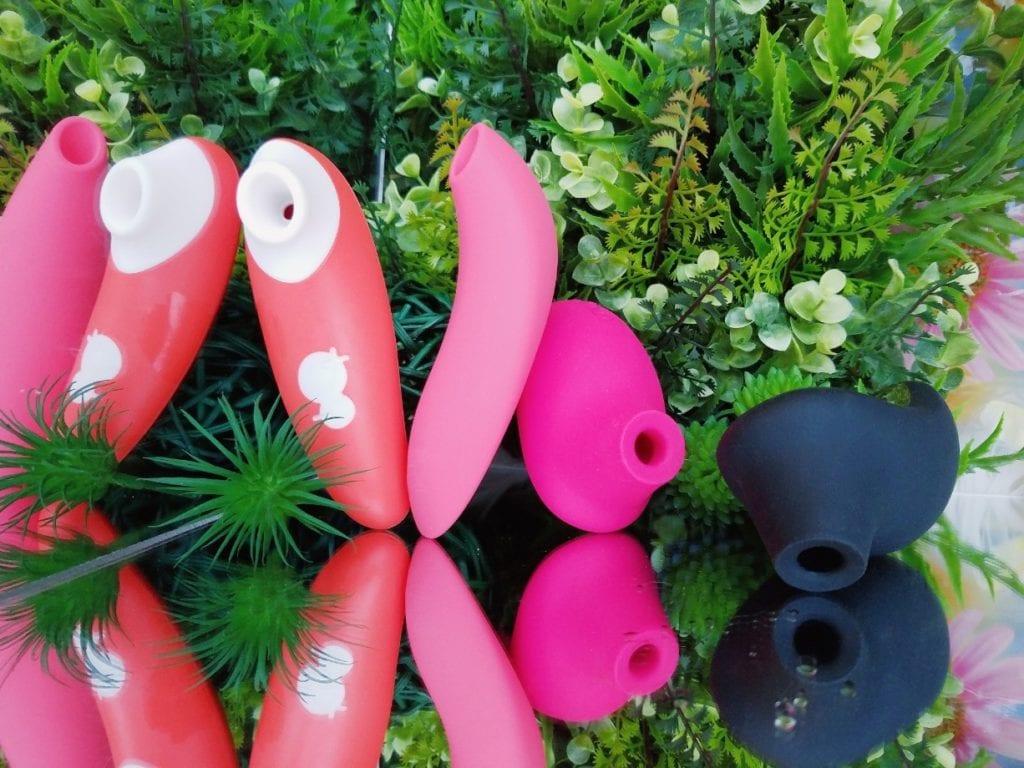[Image: orange ROMP Switch, coral We-Vibe Melt, hot pink LELO Sona 2, and black LELO Sona 2 Cruise]